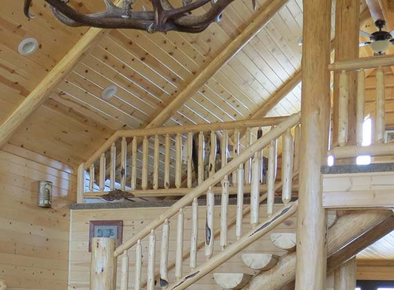 Arbogast Custom Log Home Stairway Living Room